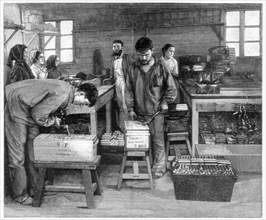 Packing cartridges into boxes at Isleten, near Fluelen, Switzerland, 1893. Artist: Unknown