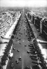 View of the Avenue des Champs Elysees, Paris, 1931.Artist: Ernest Flammarion