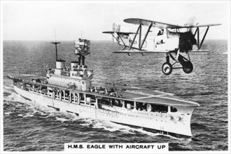The aircraft carrier HMS 'Eagle' and a Fairey Flycatcher aircraft, (1937). Artist: Unknown