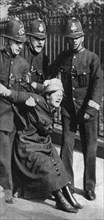 A suffragette being arrested, c1910s (1935). Artist: Unknown
