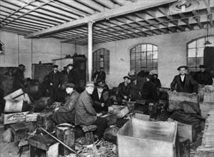 A wood-chopping workshop, London, 1926-1927. Artist: Unknown