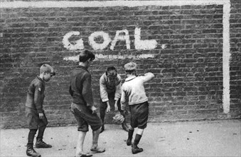 Football in the East End, London, 1926-1927. Artist: Unknown