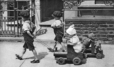 Young children playing in the street, London, 1926-1927. Artist: Unknown