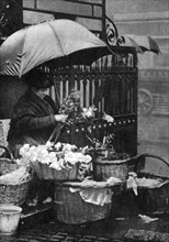Flower seller, Piccadilly Circus, London, 1926-1927. Artist: Unknown