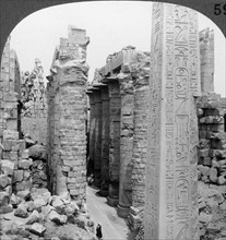 'Middle aisle of the great hall and obelisk of Thutmosis I, temple at Karnak, Thebes, Egypt', 1905.Artist: Underwood & Underwood