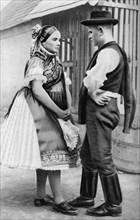 A young Slovak couple, Hungary, 1926.Artist: AW Cutler