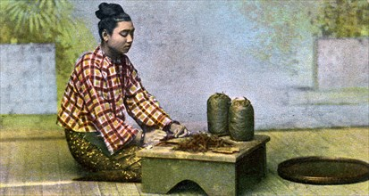 A Burmese woman making cigars, c1900s. Artist: Unknown