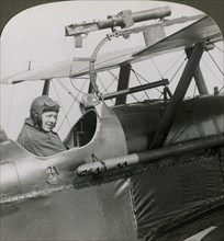 Sopwith Scout with photographic gun mounted on the upper wing, World War I, 1914-1918.Artist: Realistic Travels Publishers