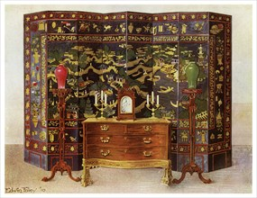 Curved commode table and Chinese lacquered eight fold screen, 1911-1912.Artist: Edwin Foley