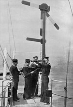 Signalling by semaphore on board HMS 'Camperdown', 1895. Artist: Gregory & Co