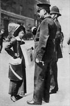 A suffragette confronting two policemen, 1913 (1937).Artist: Sport & General