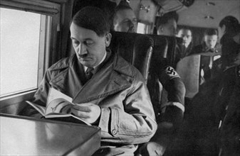 Adolf Hitler on an aeroplane, 1936. Artist: Unknown
