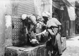 People collecting water from a well, Rabat, Morocco, c1920s-c1930s(?). Artist: Unknown