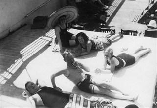 Passengers sunbathing on board a cruise ship, c1920s-c1930s(?). Artist: Unknown