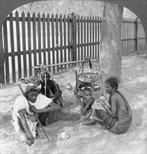 Breakfast by the roadside near Mandalay, Burma, 1908.  Artist: Stereo Travel Co