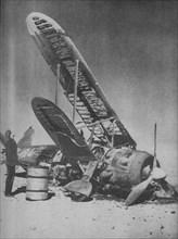 'Crashed in the Regia Aeronautica's Graveyard', 1941.  Artist: Unknown.