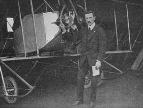 One of the best instructors: Lewis WF Turner standing by a Caudron training biplane, 1913 (1934). Artist: Flight Photo.