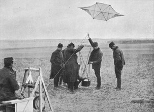 'Sending up one of the French war kites, to which a camera is attached', 1914, (1915). Artist: Unknown.