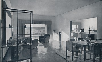 'Paniconi and Pediconi. A dining room with a large window and curtains designed to frame a beautiful Artist: Unknown.