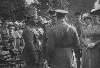 'H.M. King George V Talking To Sir Walter Lawrence and Mir Dast, V.C., 25th August 1915', (1939). Artist: Unknown.