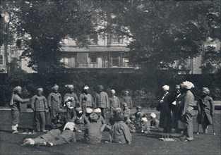 'Convalescent Indian Soldiers Playing Quoits on the Eastern Lawns', c1915, (1939). Artist: Unknown.