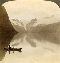 'On sombre Lake Olden, between cloud-covered mountains, to Maelkevold glacier, Norway', 1905. Creator: Unknown.