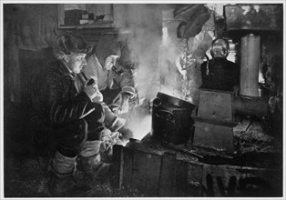 'Oates and Meares at the Blubber Stove in the Stables', Antarctica, 1911. Artist: Herbert Ponting