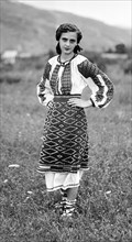 Young woman in traditional dress, Bistrita Valley, Moldavia, north-east Romania, c1920-c1945. Artist: Adolph Chevalier