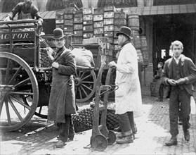 Unloading at Billingsgate Market, London, 1893. Artist: Paul Martin