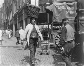 Fish porters at Billingsgate Market, London, 1893.  Artist: Paul Martin