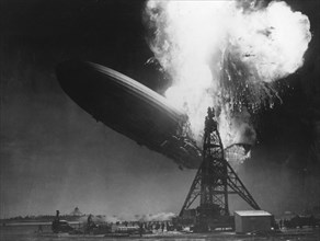 The 'Hindenburg', moments after catching fire, Lakehurst, New Jersey, 6 May 1937. Artist: Unknown