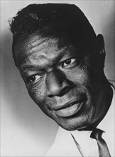 Nat King Cole, American jazz singer-songwriter and pianist, c1960s. Artist: Unknown