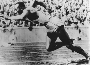 Jesse Owens, American athlete, competing in the Olympics in Berlin, Germany, 1936. Artist: Unknown