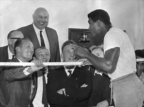 Henry Cooper meets Cassius Clay (Muhammad Ali) in a north London gymnasium, 1966. Artist: Unknown