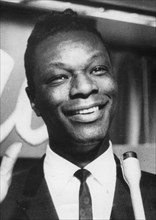 Nat King Cole (1919-1965), American jazz singer-songwriter and pianist, c1940s. Artist: Unknown