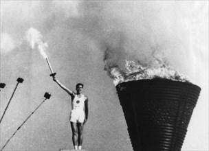 Yoshinori Sakai lights the Olympic cauldron, Summer Olympic Games, Tokyo, 1964. Artist: Unknown
