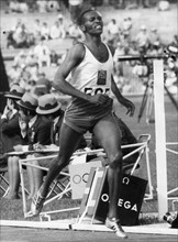 Kip Keino (1940) winning the 1500 metres at the Mexico Olympics, 1968. Artist: Unknown