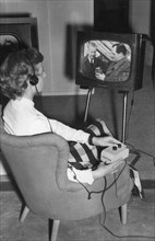 A radio and television listening aid for the deaf, Radio Exhibition, Earl's Court, London, 1952. Artist: Unknown