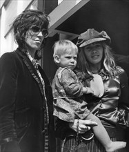 Keith Richards and Anita Pallenberg with baby Marlon, Heathrow, London, 1970. Artist: Unknown