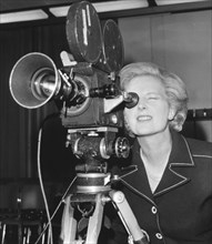 Margaret Thatcher looking through a BBC camera at Heathrow Airport, 6th September 1976. Artist: Unknown