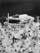 Dick Fosbury (b1947) performing his famous 'fosbury flop' during the Mexico Olympics, 1968. Artist: Unknown