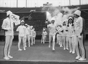 Japanese ice skater Tomoo Kurosawa with olympic torch, Sapporo, Japan, 1972. Artist: Unknown