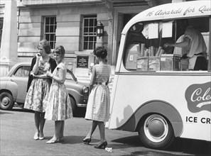 Young women by an ice cream van, c1960.