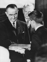 Robert F Kennedy accepts his brother's award from President Lyndon Johnson, December 1963. Artist: Unknown