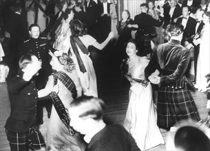 Princess Elizabeth dancing at the Royal Caledonian Tartan Ball, June 1946. Artist: Unknown