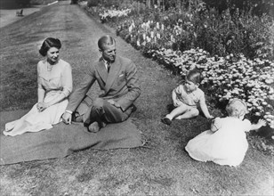 The Royal family in the gardens of Clarence House, London, 1951. Artist: Unknown