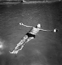 A man takes a refreshing dip in a swimming pool during the hot summer, Sweden, 1943. Artist: Karl Sandels