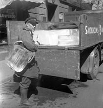 Iceman busy during the heatwave in Stockholm, Sweden, 24th July 1943. Artist: Karl Sandels