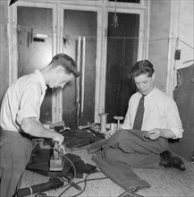 Tailors sewing and ironing, Landskrona, Sweden 1952. Artist: Unknown