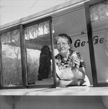 The first ice cream of the year; woman in her ice cream stall, Landskrona, Sweden, 1953. Artist: Unknown